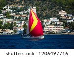 sailing yacht under red... | Shutterstock . vector #1206497716