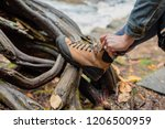 Woman Tying Hiking Boot...