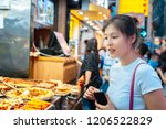 chinese asian female looking... | Shutterstock . vector #1206522829
