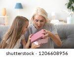 excited granddaughter open... | Shutterstock . vector #1206608956