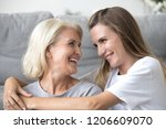 happy elderly mother and... | Shutterstock . vector #1206609070
