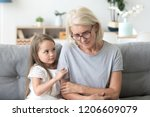 cute little girl hug upset... | Shutterstock . vector #1206609079