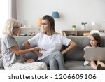 little girl watch mother and... | Shutterstock . vector #1206609106