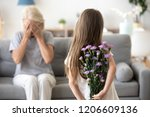 little girl holding flowers... | Shutterstock . vector #1206609136
