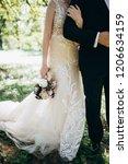 bride holding wedding bouquet | Shutterstock . vector #1206634159