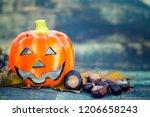 hallowen pumpkin on a wooden...