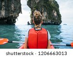 woman paddles kayak in the calm ... | Shutterstock . vector #1206663013