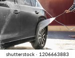 worker cleaning automobile with ... | Shutterstock . vector #1206663883
