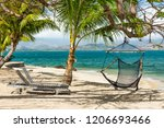 hammock hanging under the palm... | Shutterstock . vector #1206693466