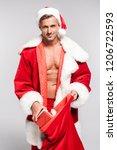 sexy man in santa costume... | Shutterstock . vector #1206722593
