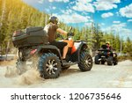 two quad bike riders in helmets ... | Shutterstock . vector #1206735646