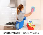 woman cleaning kitchen with rag ... | Shutterstock . vector #1206747319