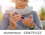 woman checking blood sugar... | Shutterstock . vector #1206751123