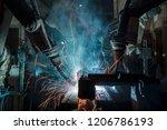 industrial team robots are... | Shutterstock . vector #1206786193