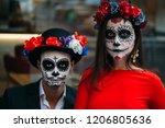 a couple  wearing skull make up ... | Shutterstock . vector #1206805636