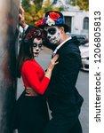 A Couple  Wearing Skull Make U...
