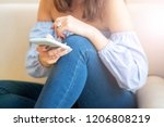 cropped shot of woman using... | Shutterstock . vector #1206808219