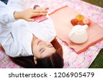 woman playing on smartphone... | Shutterstock . vector #1206905479