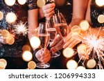friends celebrating christmas... | Shutterstock . vector #1206994333