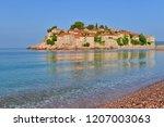 sveti stefan island and beach ...   Shutterstock . vector #1207003063