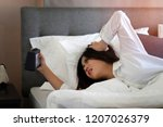 asian young woman sleeping on... | Shutterstock . vector #1207026379
