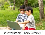 happy asian kids in glasses and ... | Shutterstock . vector #1207039093