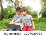 happy asian kids in glasses and ... | Shutterstock . vector #1207039096
