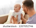 family  parenthood and people... | Shutterstock . vector #1207052746