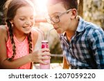 boy and girl in love sharing a... | Shutterstock . vector #1207059220