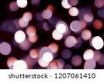 a warm festive bokeh design... | Shutterstock . vector #1207061410