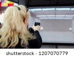 woman shooting in virtual... | Shutterstock . vector #1207070779