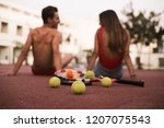 couple sitting on the floor... | Shutterstock . vector #1207075543