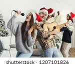 happy couple playing on guitar... | Shutterstock . vector #1207101826