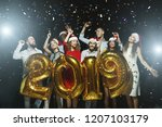 young people holding gold 2019... | Shutterstock . vector #1207103179