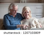 smiling aged husband showing...   Shutterstock . vector #1207103809