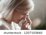 close up of aged woman feel...   Shutterstock . vector #1207103860