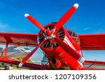propeller of red biplane  in a...