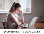thoughtful frustrated young... | Shutterstock . vector #1207123156