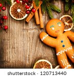 gingerbread man over wood.... | Shutterstock . vector #120713440