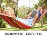 senior man relaxing in hammock...   Shutterstock . vector #120714610