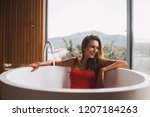 woman bathing and relaxing in a ... | Shutterstock . vector #1207184263