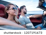 close up.the couple traveling... | Shutterstock . vector #1207191673