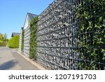 modern privacy fence of natural ... | Shutterstock . vector #1207191703