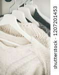 row of warm knitted sweaters... | Shutterstock . vector #1207201453