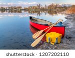 red tandem canoe with a wooden... | Shutterstock . vector #1207202110