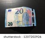 banknote of twenty euros on a... | Shutterstock . vector #1207202926