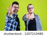 guy making ok and victory sign | Shutterstock . vector #1207213480
