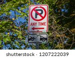 no parking any time sign towing ... | Shutterstock . vector #1207222039
