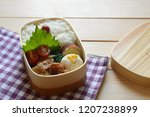 Small photo of a delicious looking lunch box (bento) consists of tofu dregs salad, ginger pork, tomato, sweet potato and steamed rice