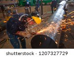 male worker wearing protective... | Shutterstock . vector #1207327729